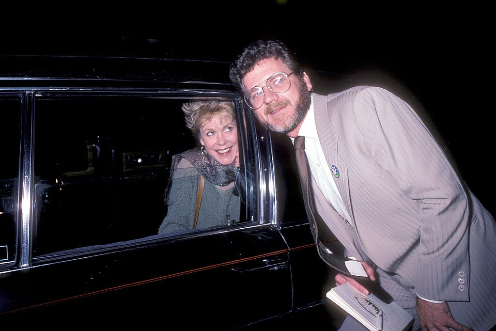 Image Credits: Getty Images / Ron Galella / Ron Galella Collection | Actress Elizabeth Montgomery and actor Robert Foxworth on May 22, 1985 outside Le Parker Meridian in New York City.