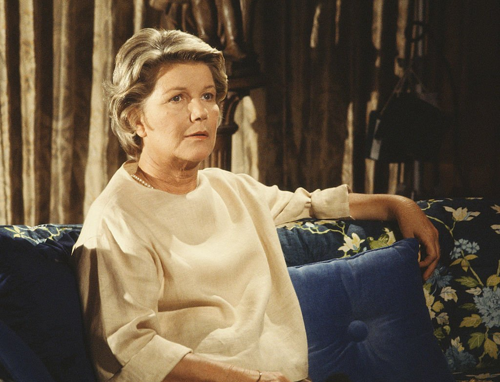 Image Credit: Getty Images / American television series 'Dallas' shows Barbara Bel Geddes (as Eleanor Southworth 'Miss Ellie' Ewing), as she sits on a sofa, 1979.