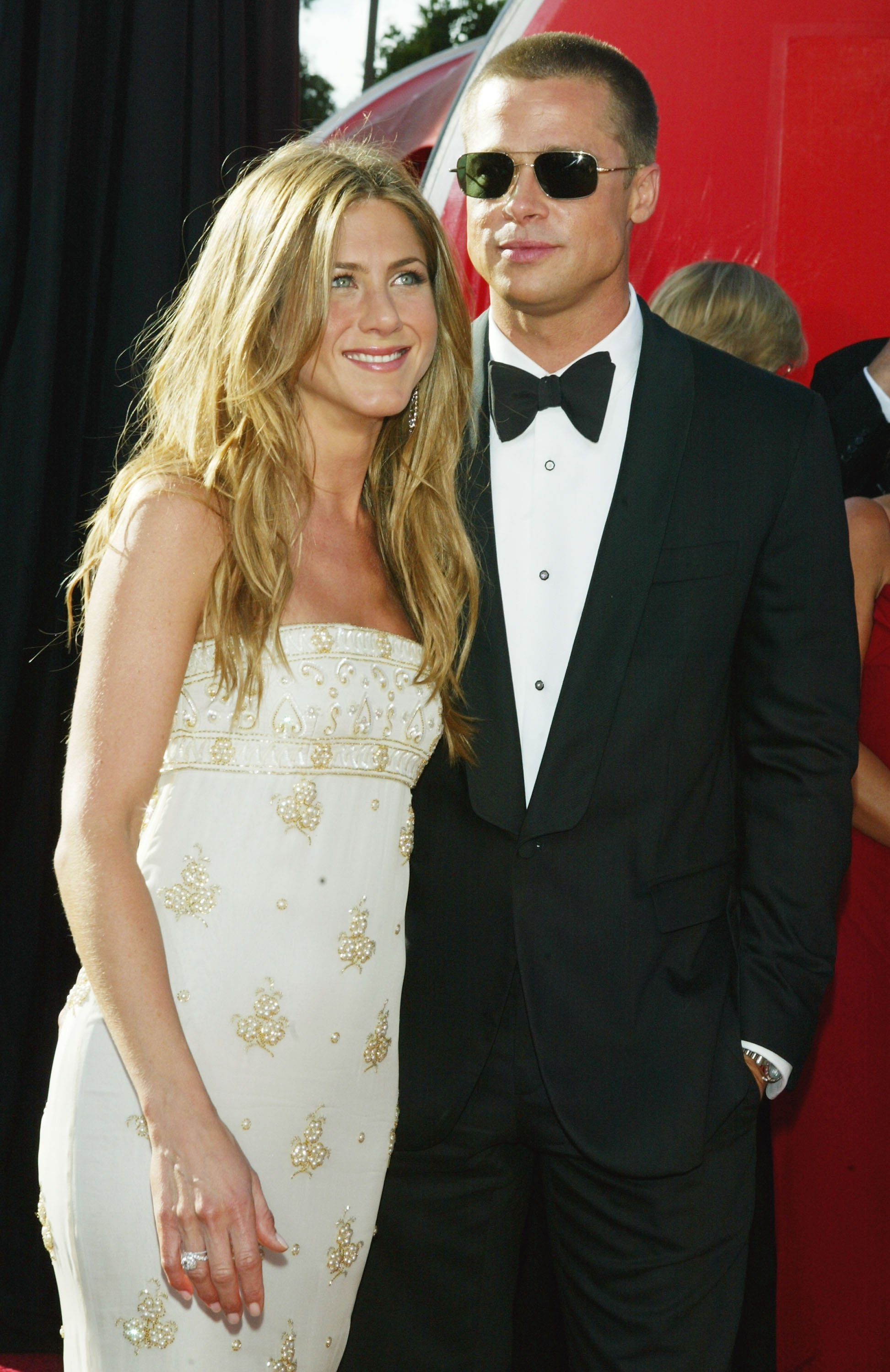 Image Credits: Getty Images / Kevin Winter | Actors Jennifer Aniston and husband Brad Pitt attend the 56th Annual Primetime Emmy Awards at the Shrine Auditorium September 19, 2004 in Los Angeles, California.