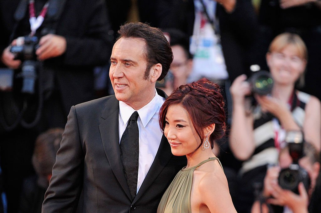 Image Credit: Getty Images / Nicolas Cage and his wife Alice Kim Cage attend the 'Joe' Premiere during The 70th Venice International Film Festival at Palazzo Del Cinema on August 30, 2013.