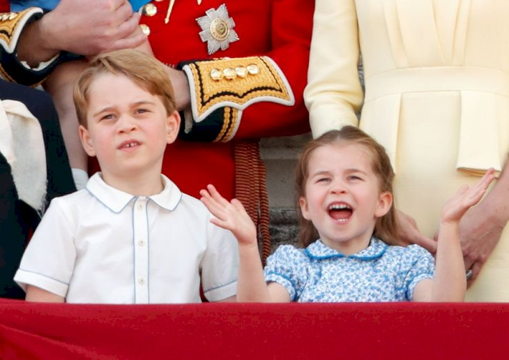 Image Credit: Getty Images / Prince George of Cambridge and Princess Charlotte of Cambridge watch a flypast from the balcony of Buckingham Palace.