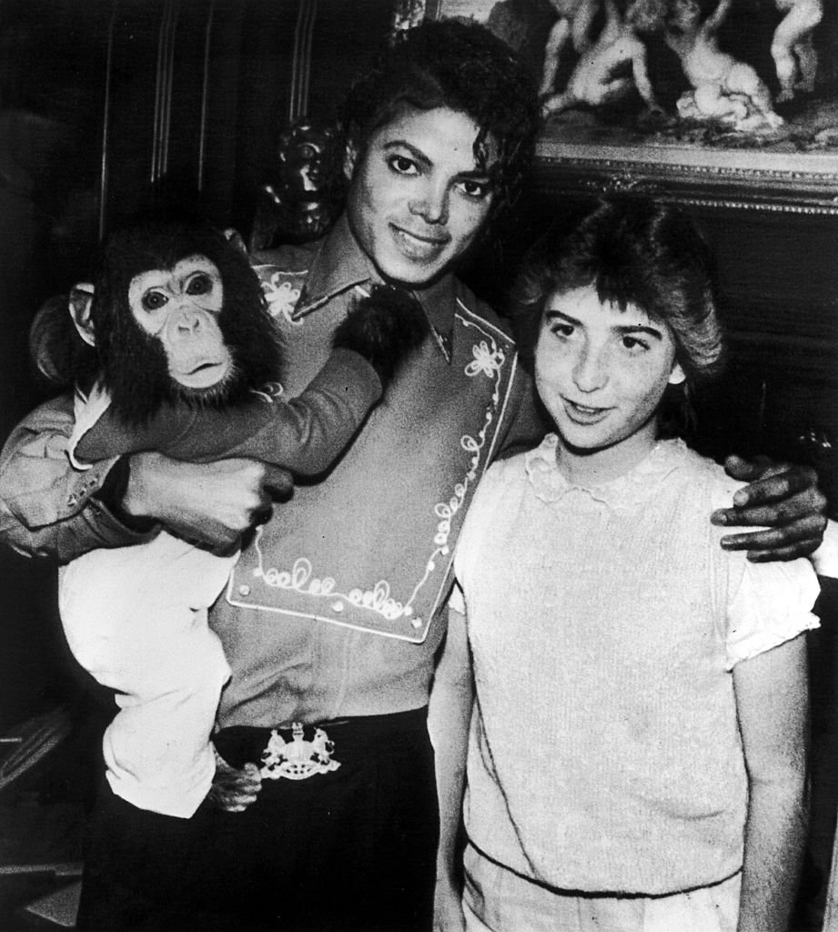 Image Credit: Getty Images / American singer Michael Jackson (1958 - 2009) poses with a fan and his pet chimpanzee Bubbles at the Neverland Ranch.