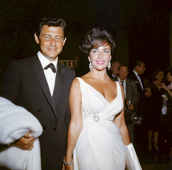 Image Credit: Getty Images/Hulton Archive | Elizabeth Taylor and her fourth husband American singer and actor Eddie Fisher