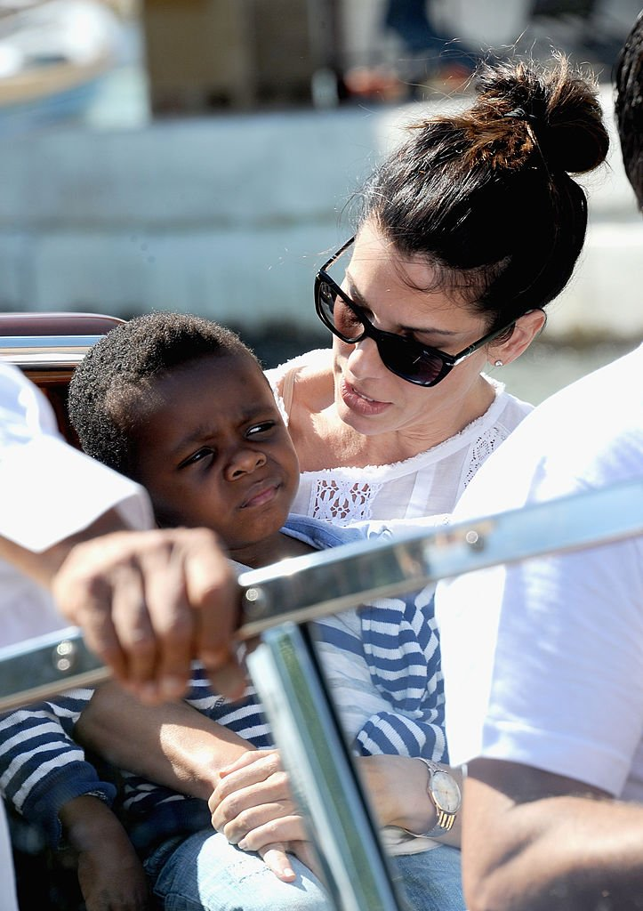 Image Credits: Getty Images / Jacopo Raule / FilmMagic | Actress Sandra Bullock (R) and son Louis Bardo Bullock is seen during the 70th Venice International Film Festival on August 27, 2013 in Venice, Italy.