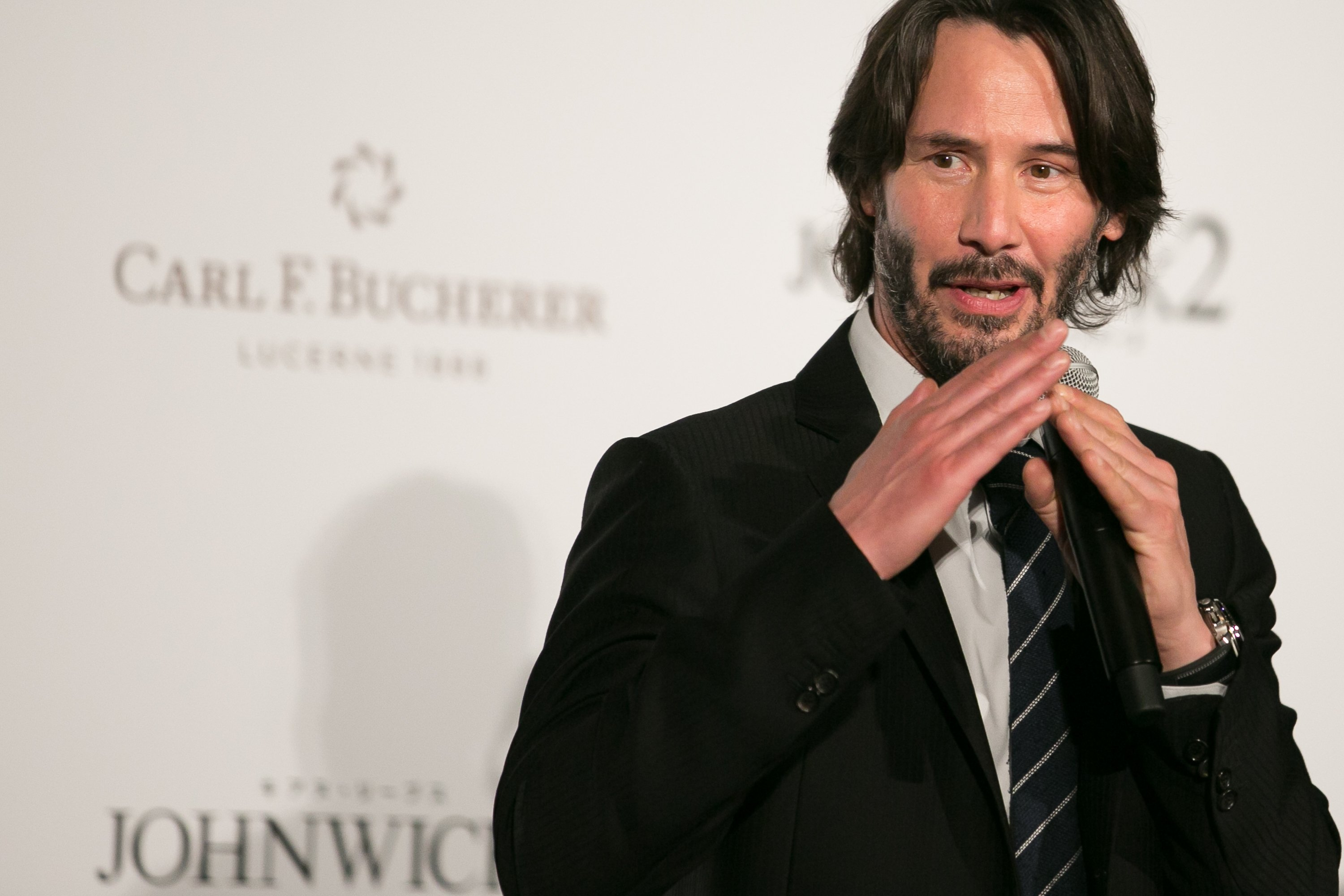 Image Source: Getty Images/Keanu speaking at a John Wick movie event