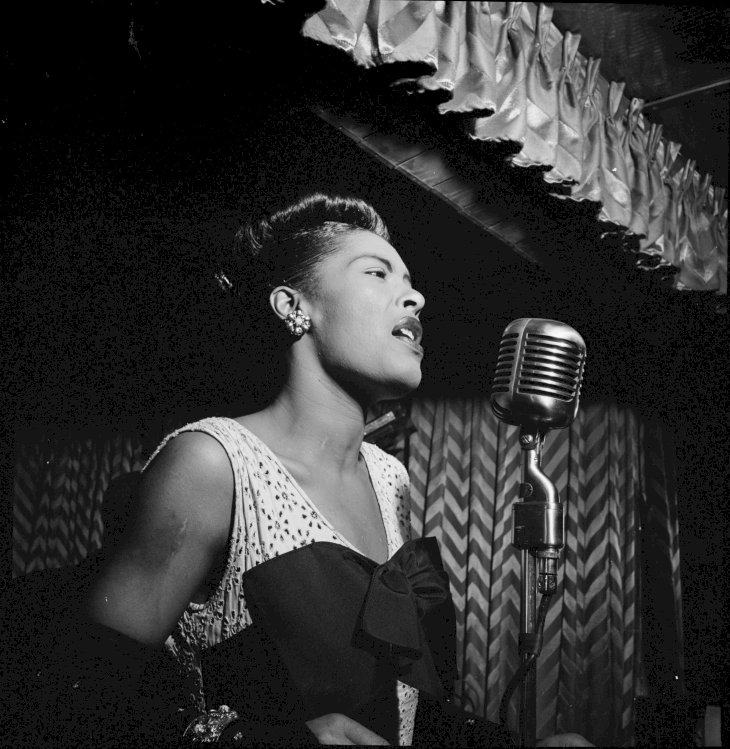 Image Credit: Getty Images / Billie Holiday performing at a show.