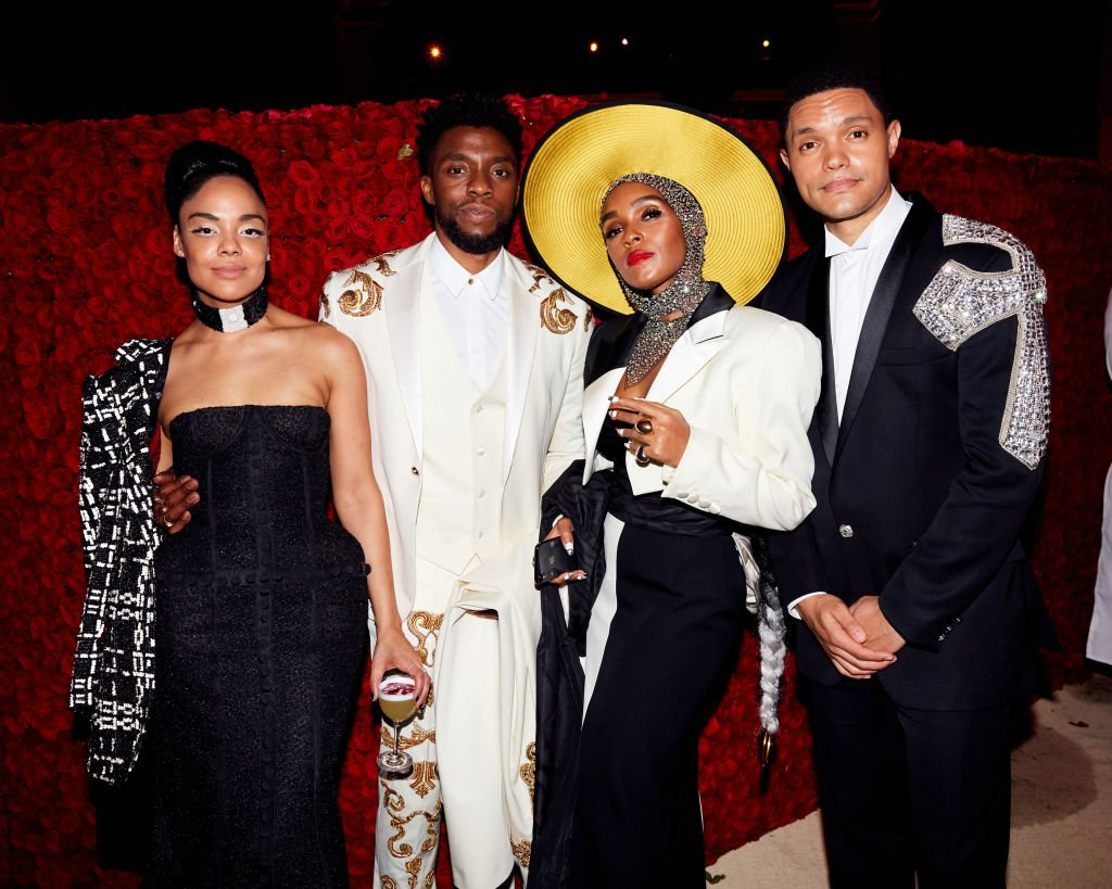 Image Credits: Getty Images / Taylor Jewell | Tessa Thompson, Chadwick Boseman, Janelle Monae, and Trevor Noah attend Heavenly Bodies: Fashion & The Catholic Imagination Costume Institute Gala at The Metropolitan Museum of Art on May 7, 2018 in New York City.