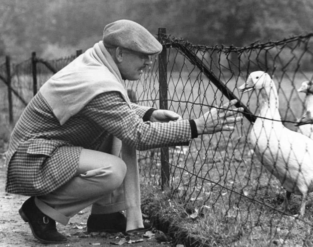 Image Credit: Getty Images / Clark Gable making friends with a goose, 1938.