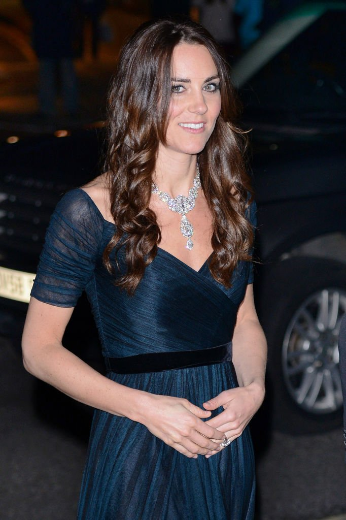 Image Source: Getty Images/Kate Middleton wearing a dark blue green chiffon dress