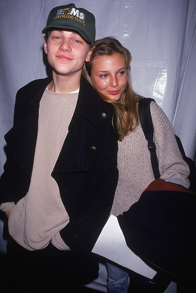 Image Source: Getty Images/Dave Allocca| Actor Leonardo DiCaprio w. model Bridget Hall.