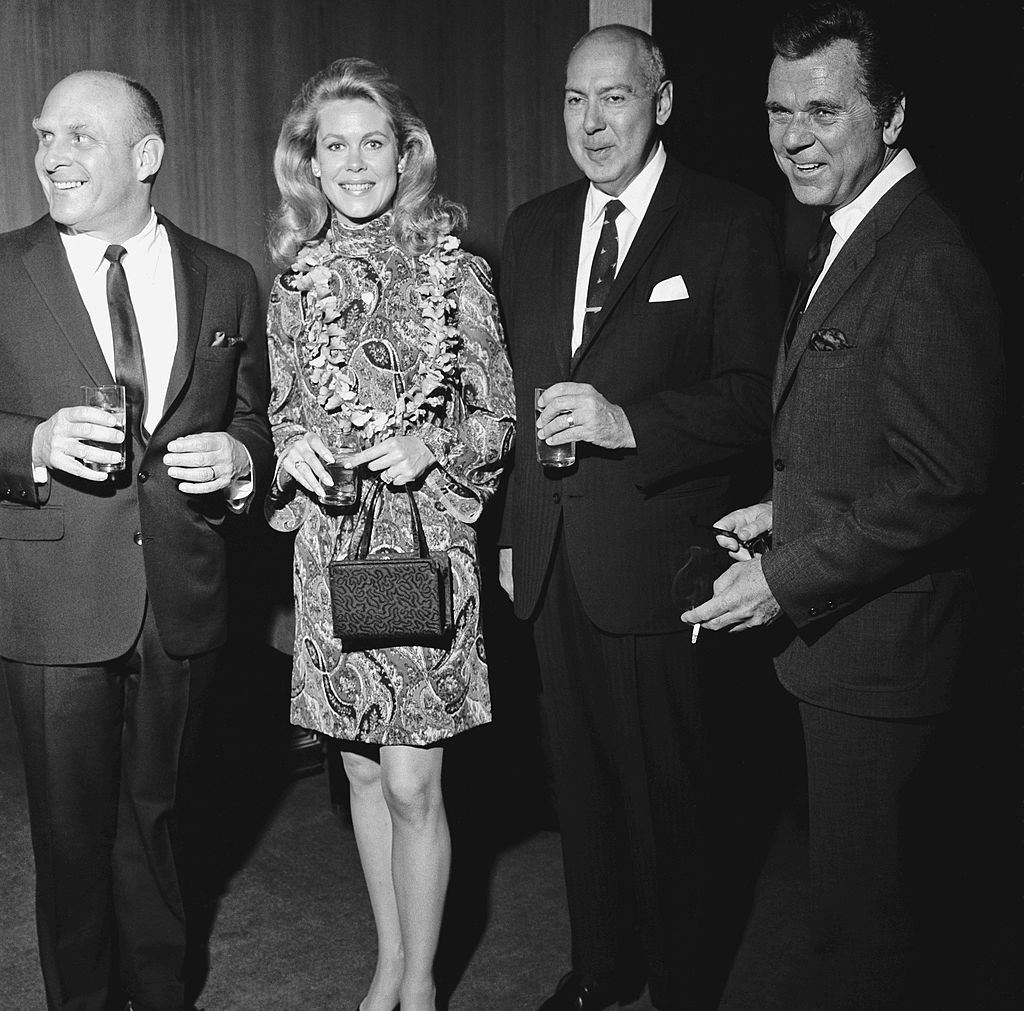 Image Credits: Getty Images / NBCU Photo Bank / NBCUniversal | Director William Asher and wife/actress Elizabeth Montgomery, actor/filmmaker Carl Reiner and actor Jackie Cooper.