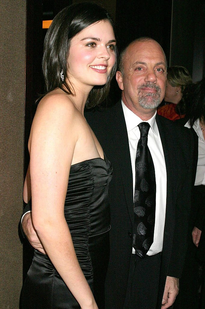 Image Credits: Getty Images / M. Von Holden / FilmMagic | Billy Joel (R) and fiance Katie Lee.