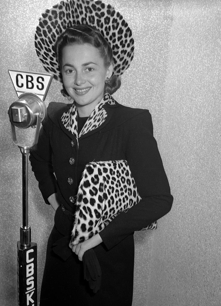 Image Credits: Getty Images / CBS | Olivia de Havilland (as Irene Dale) prepares for the CBS Lux Radio Theater adaptation of Wings of the Navy, originally broadcast October 7, 1940