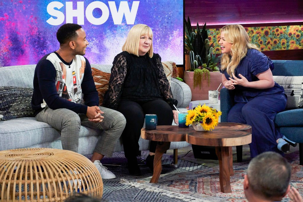 Image Credit: Getty Images / Singer, John Legend, with Jeanne Taylor, mother of Kelly Clarkson on her daughter's talk show.