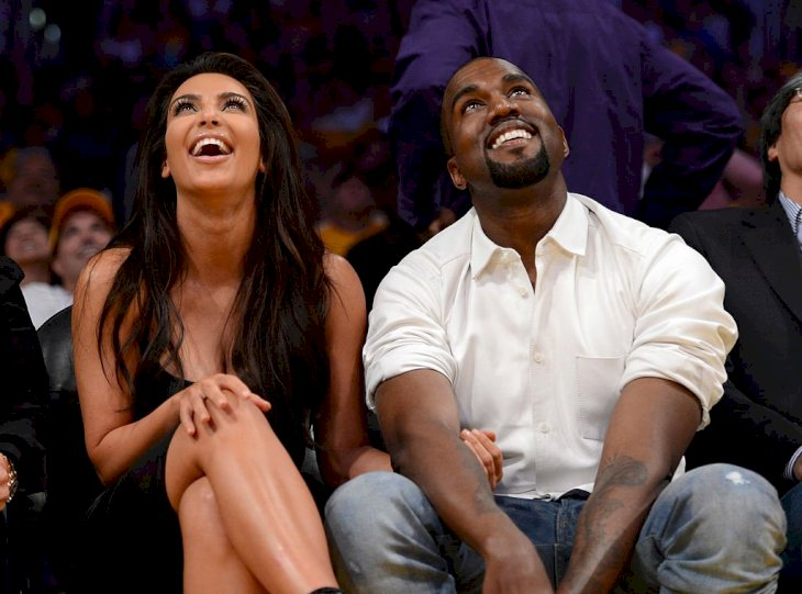 Image Credit: Getty Images / Kanye West and Kim Kardashian attend an event.