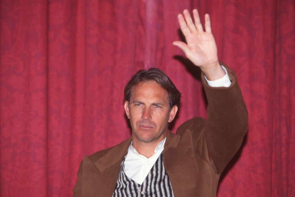 Image Credit: Getty Images / Kevin Costner waving in 1999.