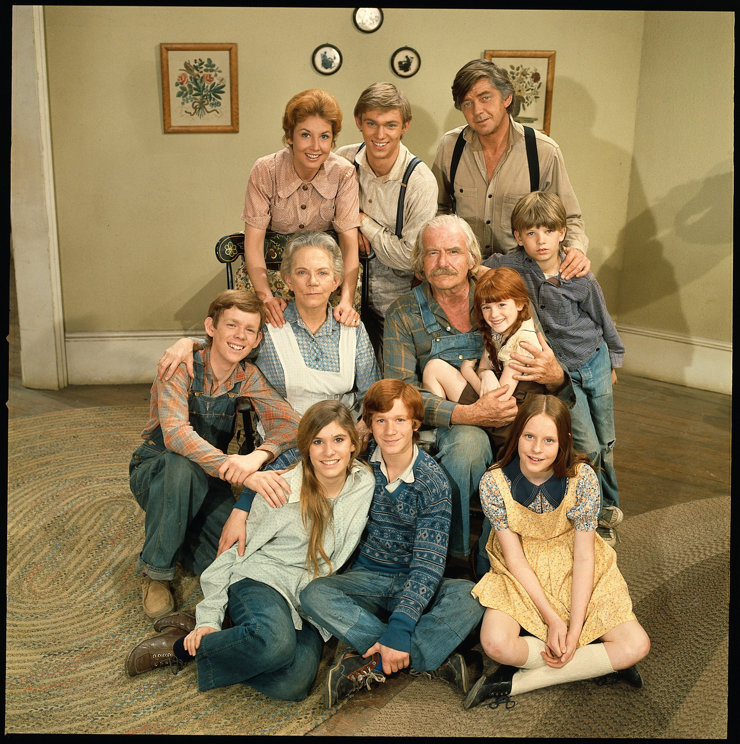 Image Credits: Getty Images / CBS | 'The Waltons''s cast poses for a promotional photo, 1972. L-R: (back row) Michael Learned, Richard Thomas and Ralph Waite; (center row) Jon Walmsley, Ellen Corby, Will Geer, Kami Cotler and David W. Harper; (bottom row) Judy Norton Taylor, Eric Scott and Elizabeth McDonough.