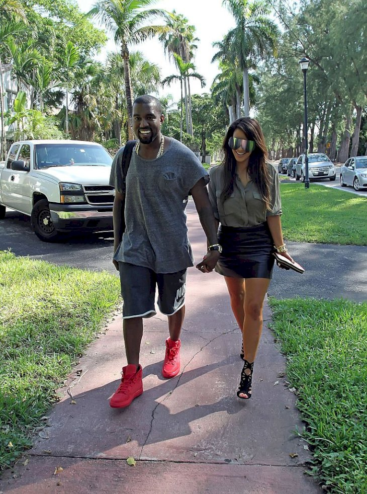 Image Credit: Getty Images / Kanye West and Kim Kardashian are photographed by the press.