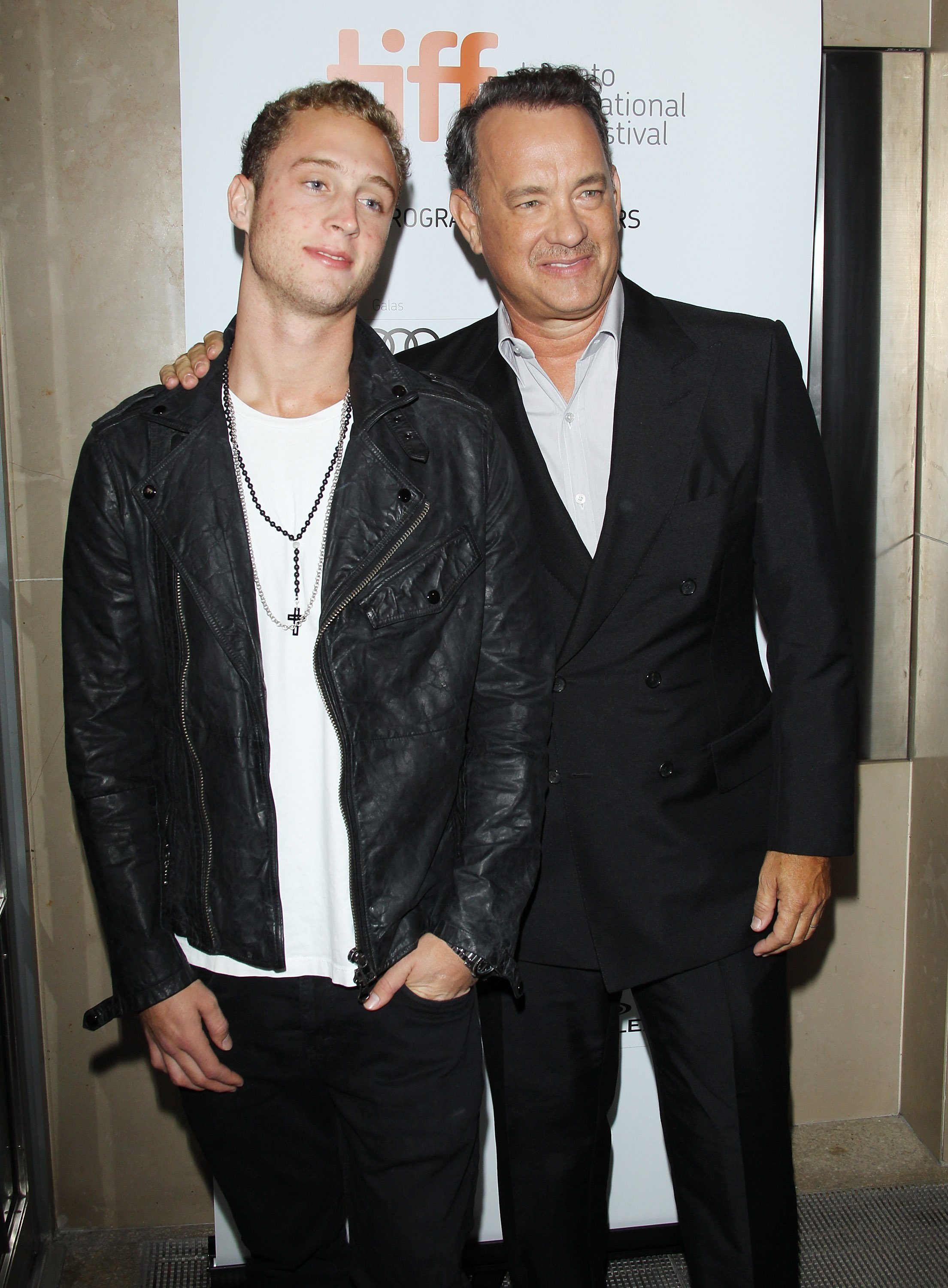 "Image Credits: Getty Images / Michael Tran / FilmMagic | Tom Hanks (R) and his son Chet Hanks arrive at ""Cloud Atlas"" premiere during the 2012 Toronto International Film Festival held at Princess of Wales Theatre on September 8, 2012 in Toronto, Canada."
