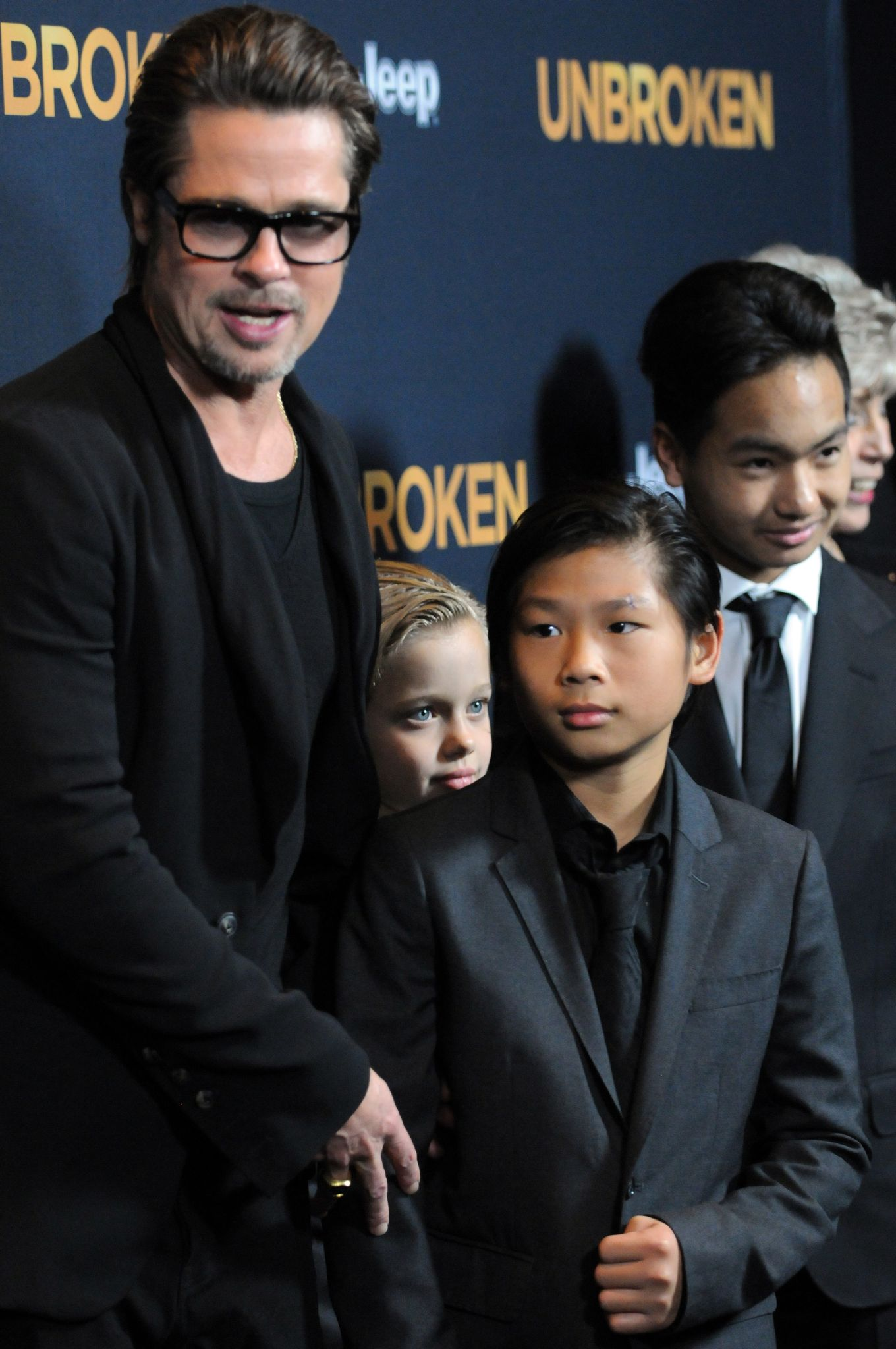 Brad Pitt with Pax, Maddox and Shiloh / Getty Images
