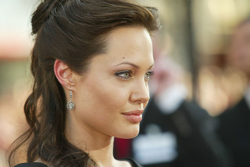 """Image Credit: Getty Images /  Actress Angelina Jolie attends the world premiere of the film """"Lara Croft Tomb Raider: The Cradle of Life"""" at Grauman's Chinese Theatre July 21, 2003 in Hollywood, California."""