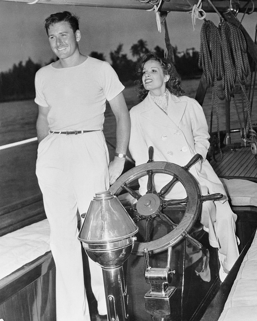 Image Source: Getty Images/Bettmann/Actor Errol Flynn and his wife, actress Lili Damita on their ketch Sirocco.