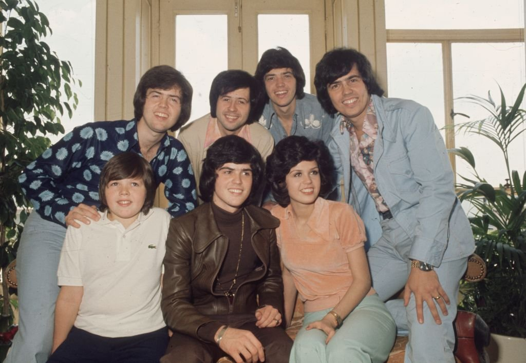 Image Credit: Getty Images / The Osmonds, known as the first family of pop, featuring Jimmy, Donny Marie, Alan, Wayne, Merrill and Jay Osmond, 1975.