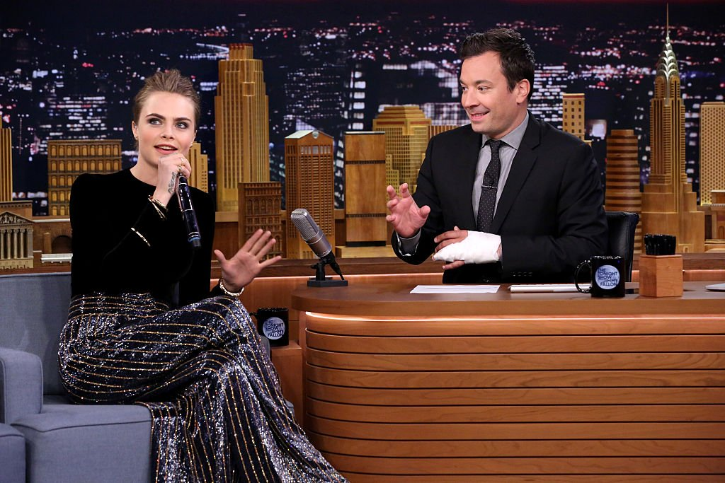Image Credit: Getty Images / Actress Cara Delevingne during an interview with host Jimmy Fallon on July 16, 2015.