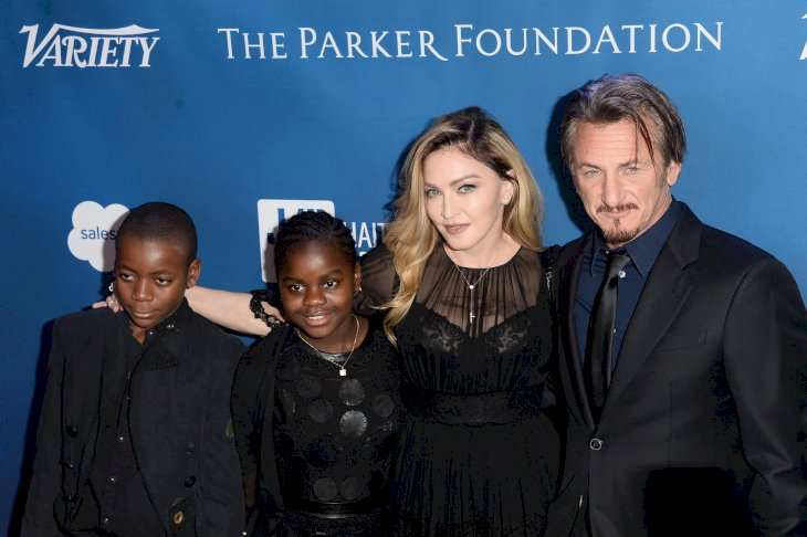 BEVERLY HILLS, CA - JANUARY 09: (L-R) David Banda, Mercy James, musician Madonna, and actor Sean Penn arrive at the 5th Annual Sean Penn & Friends HELP HAITI HOME Gala benefiting J/P Haitian Relief Organization at Montage Hotel on January 9, 2016 in Beverly Hills, California. (Photo by Matt Winkelmeyer/Getty Images)