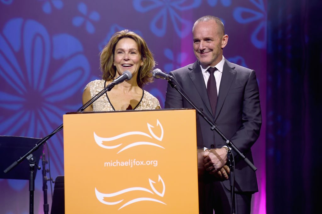 Image Credits: Getty Images / Jamie McCarthy | Jennifer Grey and Clark Gregg speak on stage at A Funny Thing Happened On The Way To Cure Parkinson's benefitting The Michael J. Fox Foundation at the Hilton New York on November 10, 2018.