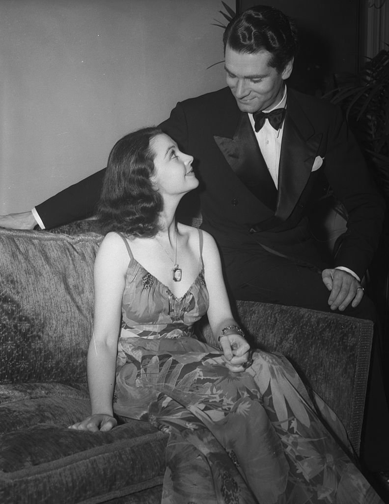 Image Credits: Getty Images /  Bettmann  | Laurence Olivier admiring Vivien Leigh