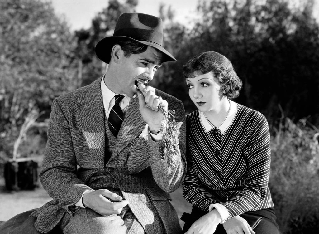 "Image Credit: Getty Images / Actress Claudette Colbert and Clark Gable in a scene from the movie ""It Happened One Night."""