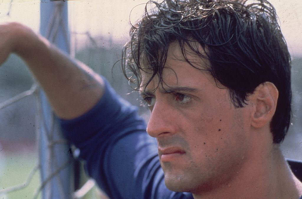 "Image Source: Getty Images/Hulton Archive | Still of Stallone in ""Victory"""