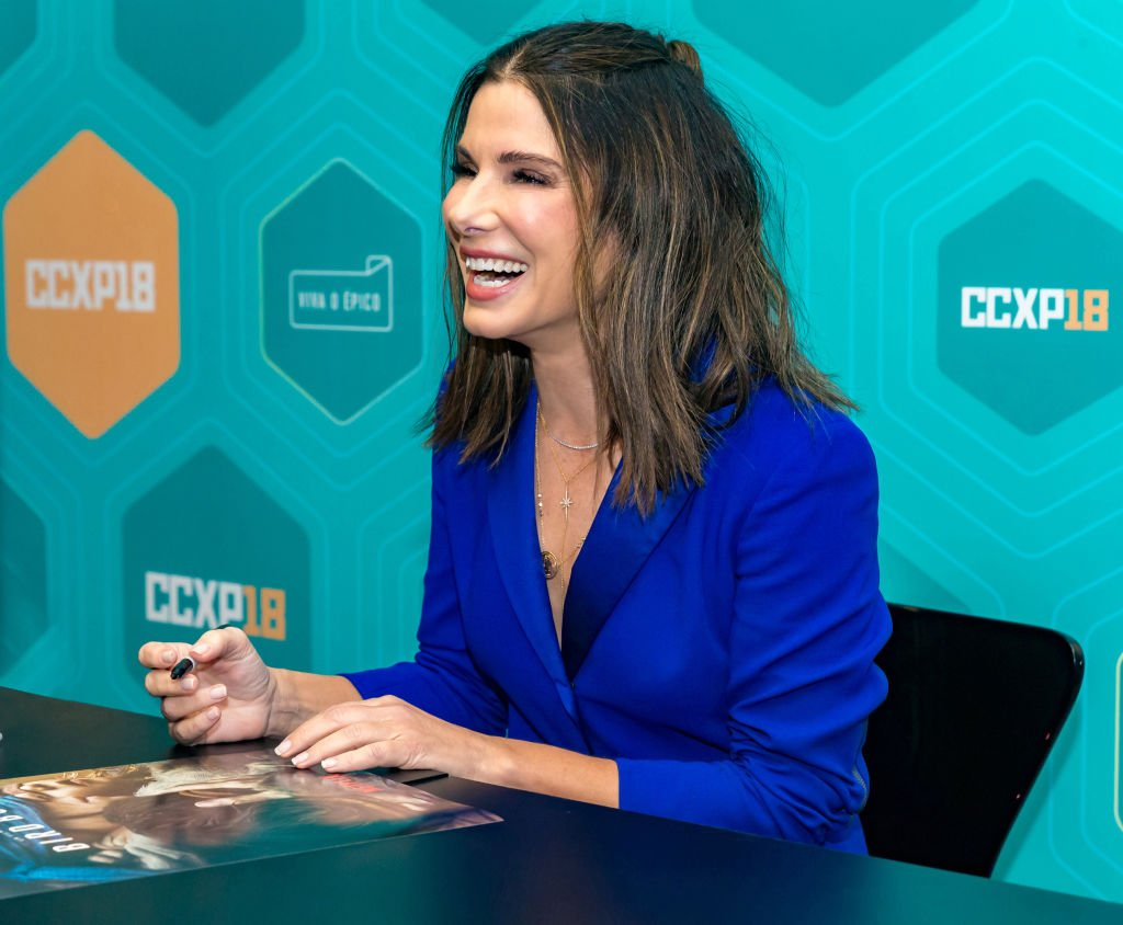 Image Credits: Getty Images / Alexandre Schneider | Sandra Bullock signs autographs at Comic-Con São Paulo on December 9, 2018 in Sao Paulo, Brazil.