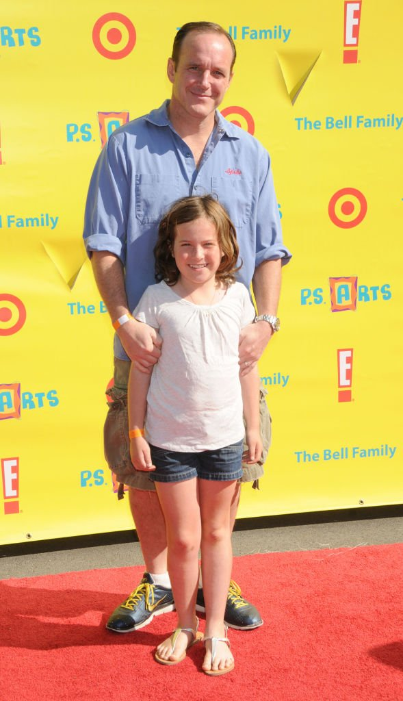 Image Credits: Getty Images / Gregg DeGuire / FilmMagic | Clark Gregg and daughter Stella arrive at the Creative Arts Fair Supporting P.S. Arts at Barker Hangar at the Santa Monica Airport on November 7, 2010 in Santa Monica, California.
