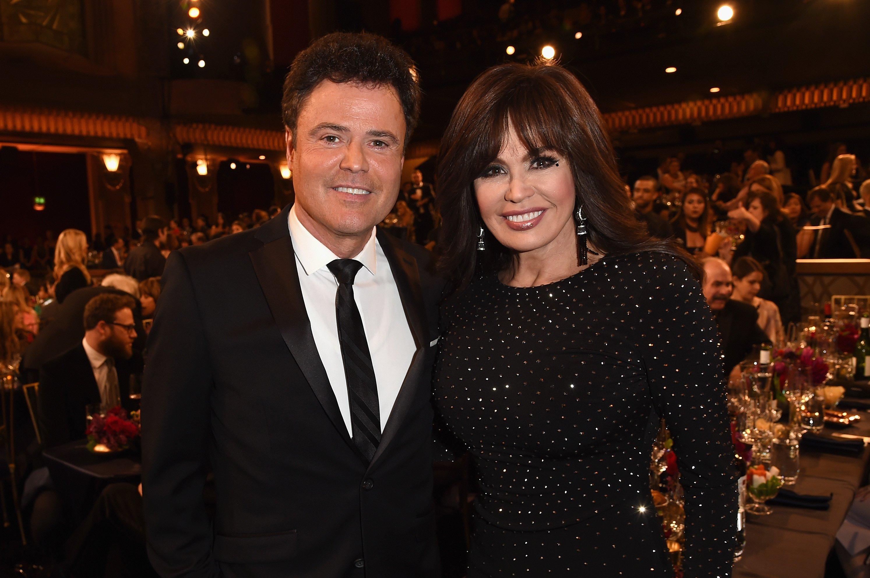 Image Credits: Getty Images / Jason Merritt | Singers Donny Osmond (L) and Marie Osmond attend the 2015 TV Land Awards at Saban Theatre on April 11, 2015 in Beverly Hills, California.