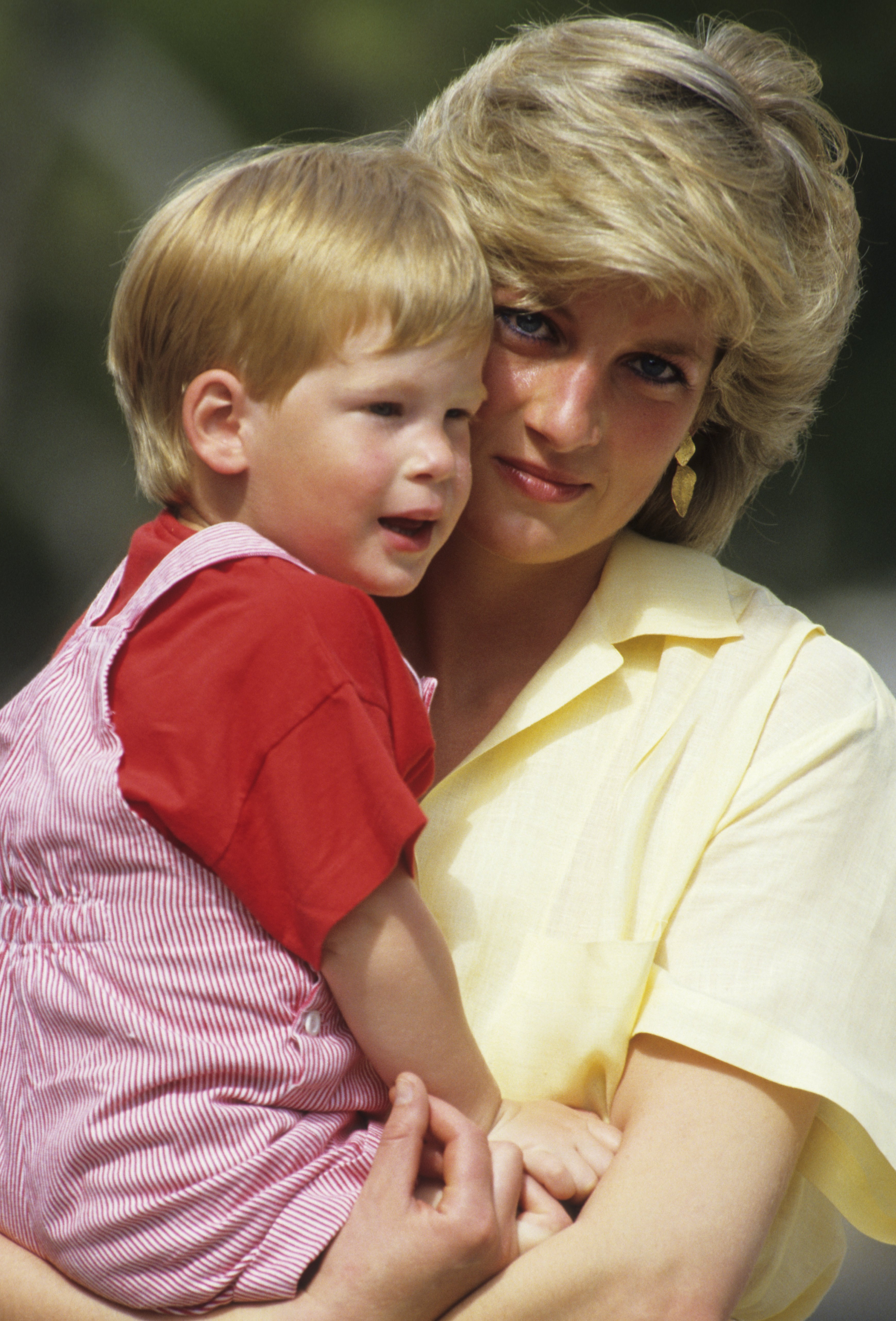 Image Credits: Getty Images / Georges De Keerle   Diana, Princess of Wales with Prince Harry on holiday in Mallorca, Spain on August 10, 1987.