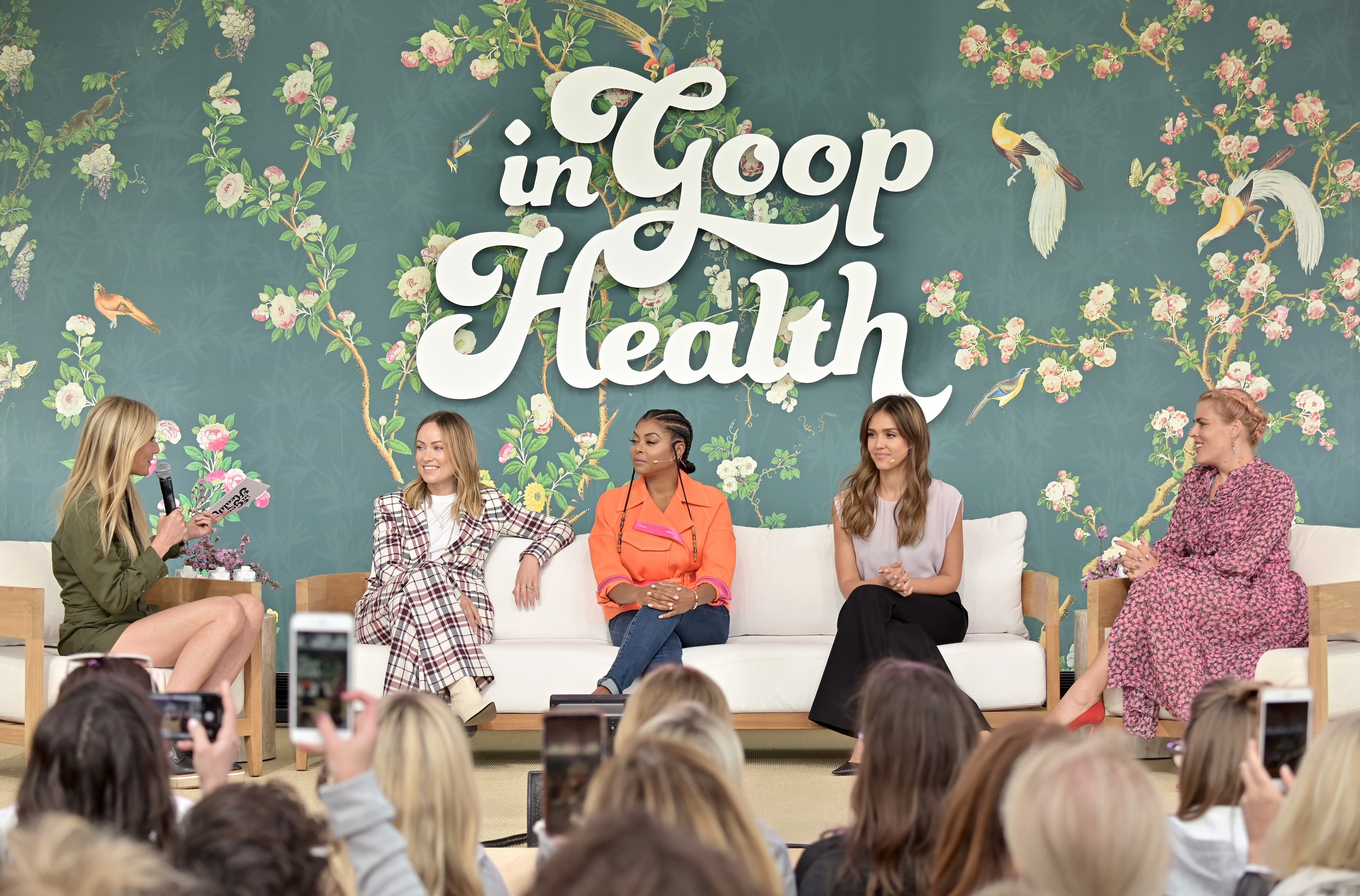 Image Credits: Getty Images / Neilson Barnard | (L-R) goop CEO Gwyneth Paltrow, Olivia Wilde, Taraji P. Henson, Jessica Alba and Busy Philipps speak onstage at In goop Health Summit Los Angeles 2019 at Rolling Greens Nursery on May 18, 2019 in Los Angeles, California.