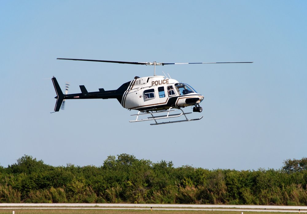 Hovering police helicopter | Shutterstock