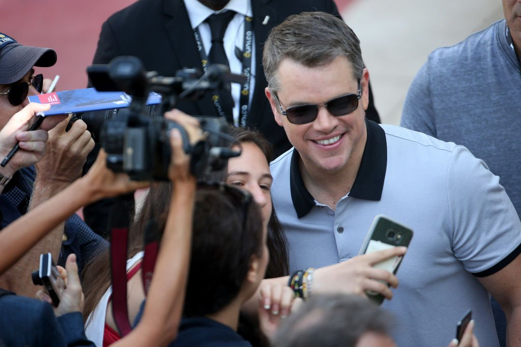Image Source: Getty Images/GC Images/Franco Origlia | Matt Damon poses for a picture with a fan