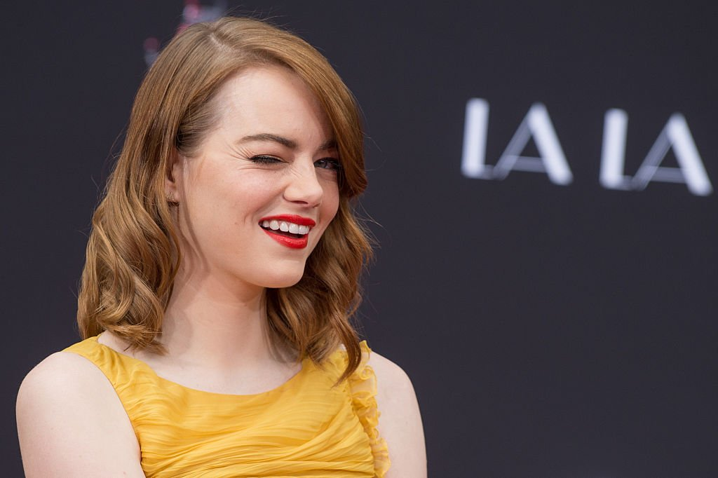 Image Credits: Getty Images / Emma McIntyre | Actress Emma Stone attends 'Ryan Gosling and Emma Stone hand and footprint ceremony' at TCL Chinese Theatre IMAX on December 7, 2016 in Hollywood, California.