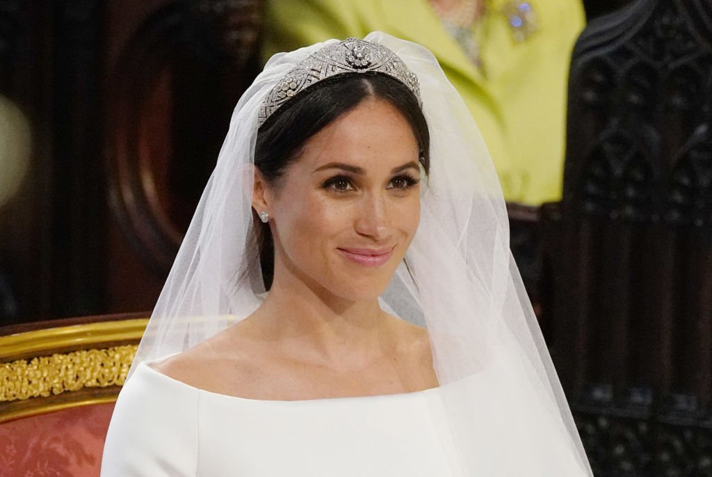 Image Credits: Getty Images / Jonathan Brady - WPA Pool   Meghan Markle stands at the altar during her wedding in St George's Chapel at Windsor Castle on May 19, 2018 in Windsor, England.