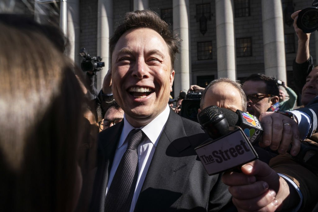 Elon Musk, chief executive officer of Tesla Inc., smiles while speaking to members of the media in New York, U.S., on Thursday, April 4, 2019.