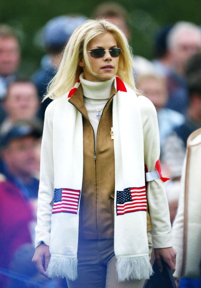 Image Credits: Getty Images / Jamie Squire | Tiger Woods girlfriend model Elin Nordegren watches on the third hole during the morning foursome matches on the second day of the 34th Ryder Cup at the De Vere Belfry in Sutton Coldfield, England on September 28, 2002.