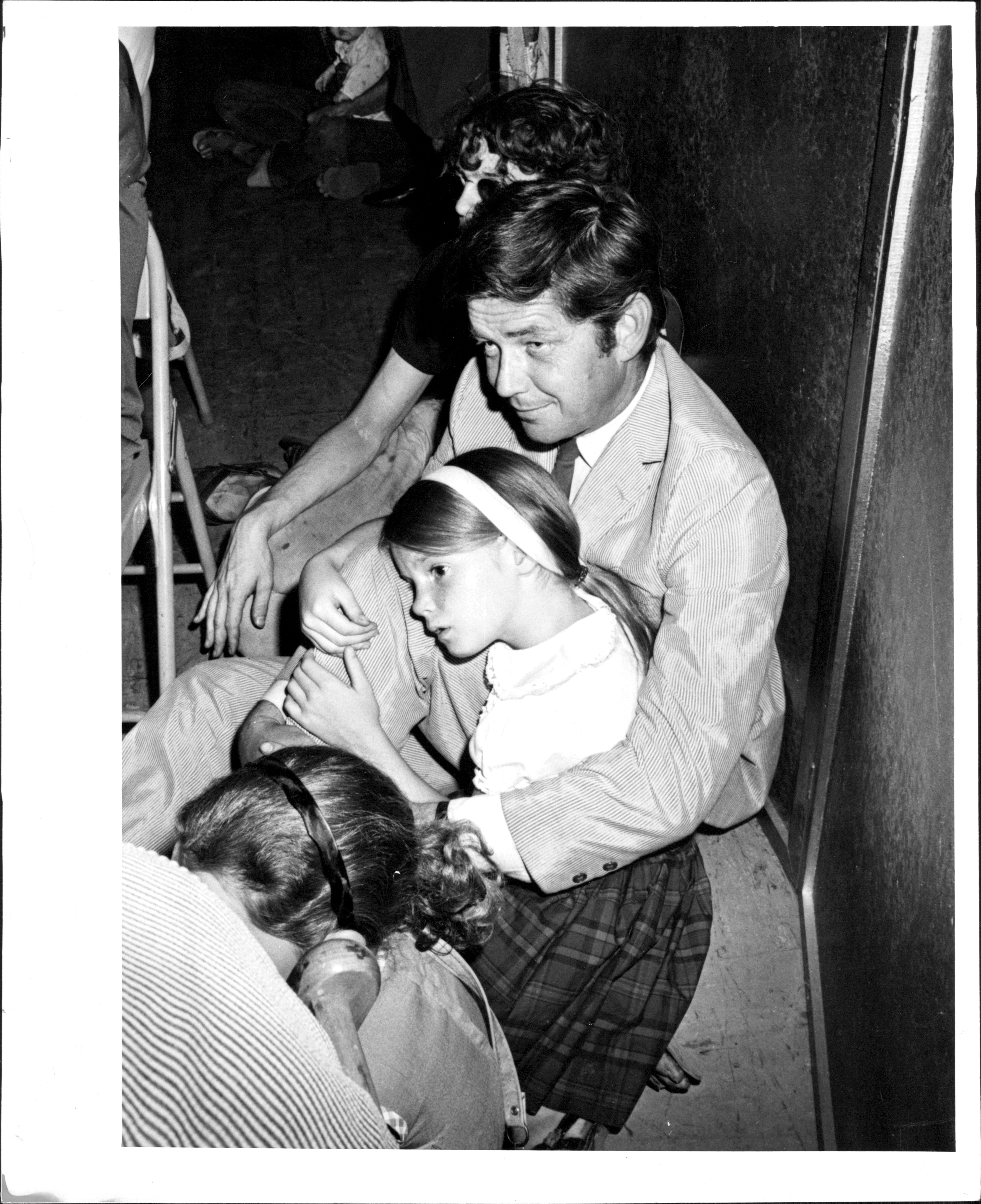 Image Credits: Getty Images / Jerry Engel | Ralph Waite, holding his daughter Kathleen, 9, was among those who attended services for Lenny Bruce at the Judson Memorial Church on Washington Square last night. August 13, 1966.