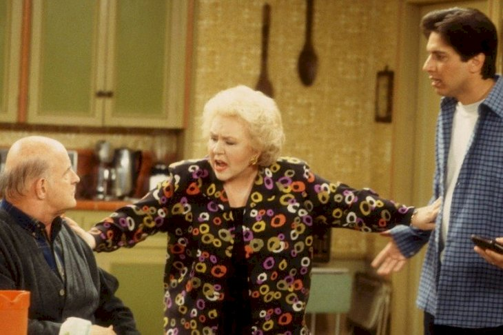 Image Credits: Getty Images / Everybody Loves Raymond actress  Doris Roberts (center, as Marie Barone) separates actors Peter Boyle (as Frank Barone) and Ray Romano (as Ray Barone)