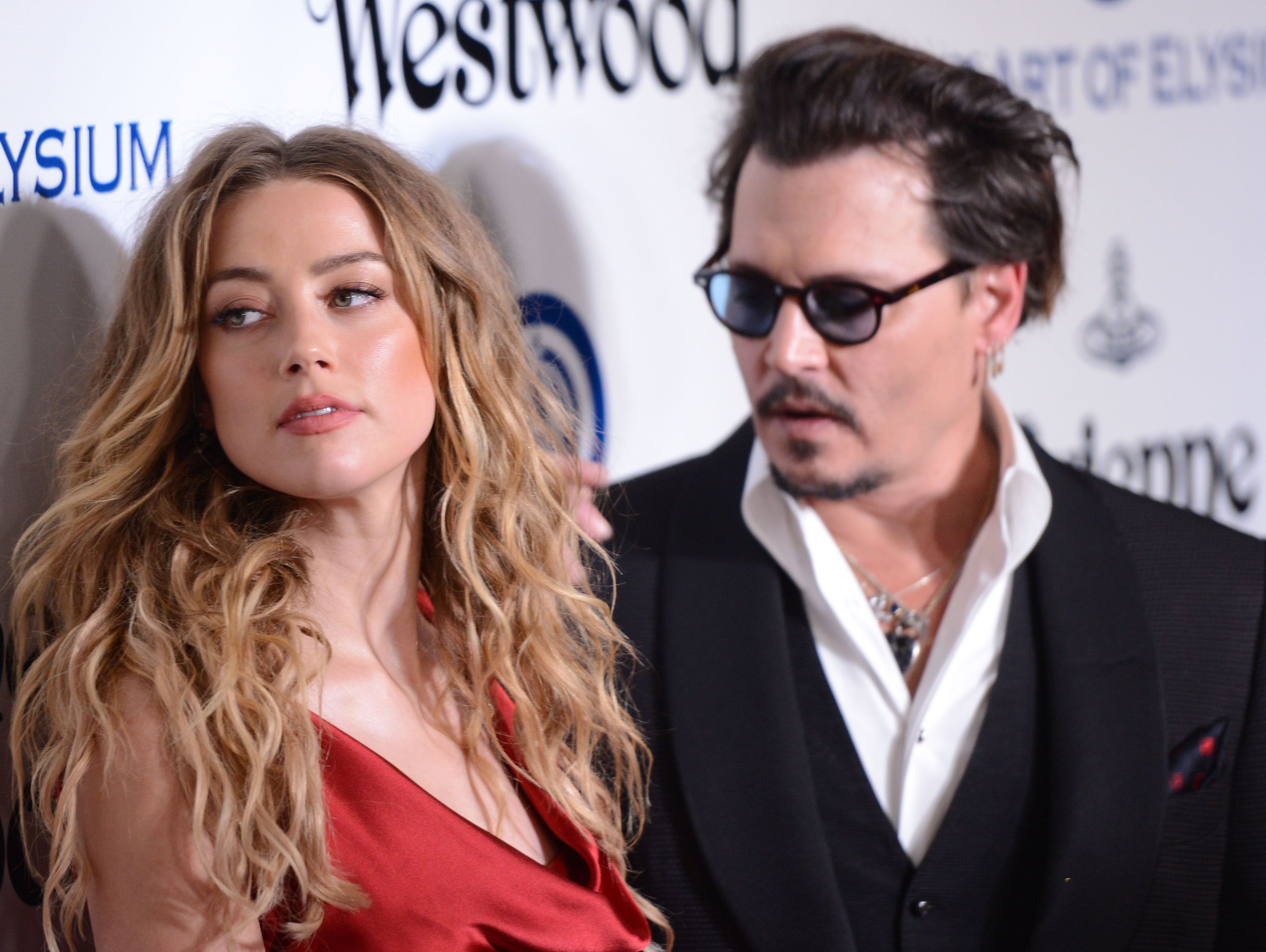 Johnny Depp and Amber Heard / Getty Images