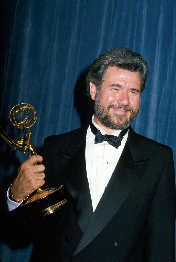 Image Credits: Getty Images / Kevin Winter/DMI/The LIFE Picture Collection | John Larroquette holding his 4th Emmy