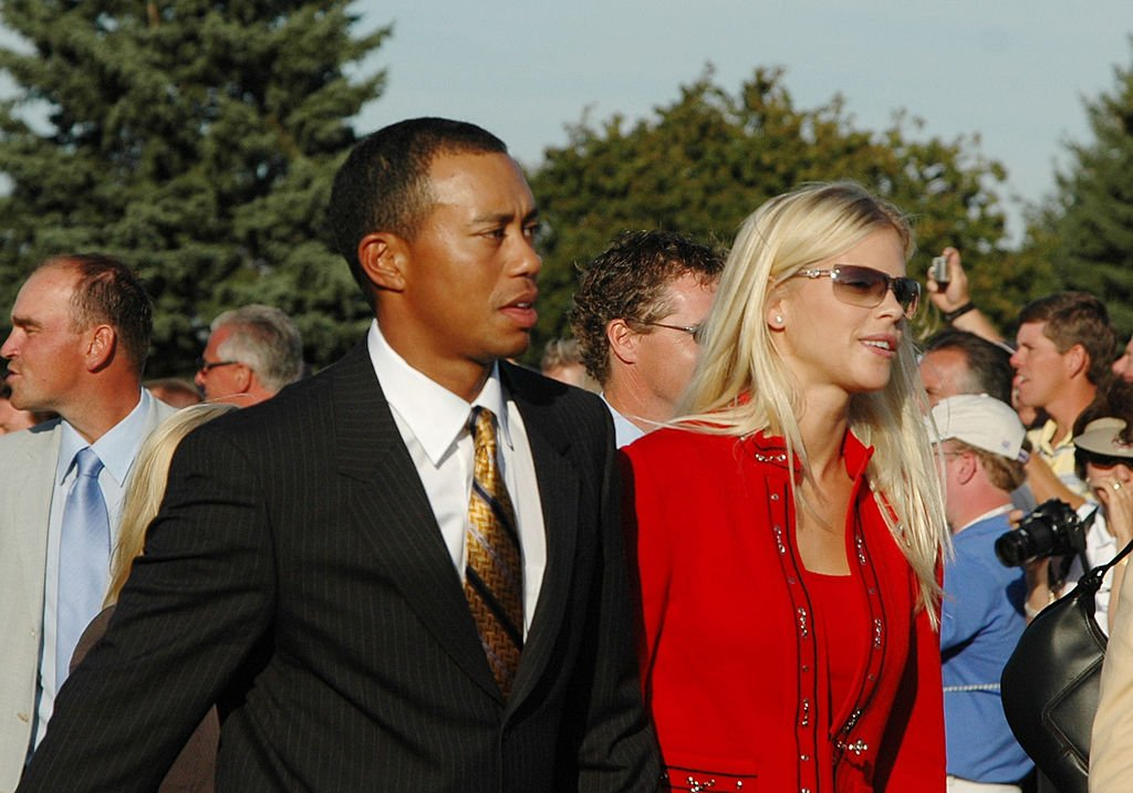 Image Credits: Getty Images / A. Messerschmidt | Tiger Woods and his girlfriend, Elin Nordegren, leave the stage after opening ceremonies at the 2004 Ryder Cup in Detroit, Michigan, September 16, 2004.