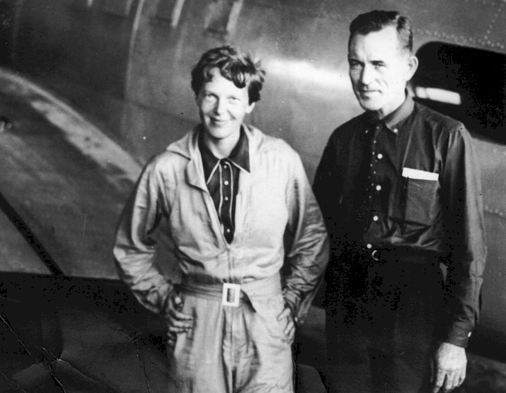 Image Credit: Getty Images / American aviatrix Amelia Earhart (1897 - 1937) with her navigator, Captain Fred Noonan, in the hangar.